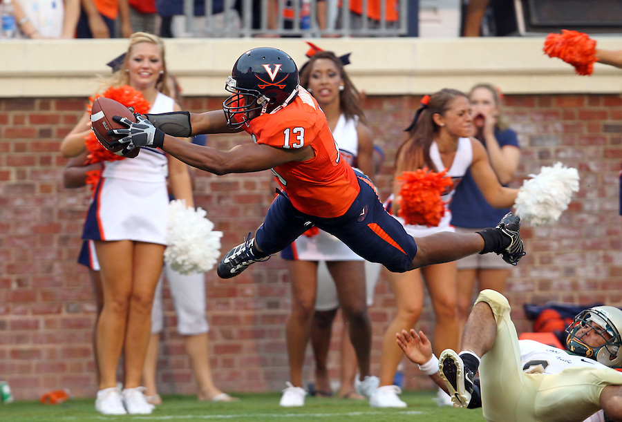 Sept. 3, 2011 - Charlottesville, Virginia - USA; Virginia Cavaliers cornerback Chase Minnifield (13) dives over William & Mary Tribe wide receiver D.J. Mangas (4) for the goal line during an NCAA football game at Scott Stadium. Virginia won 40-3. (Credit Image: © Andrew Shurtleff