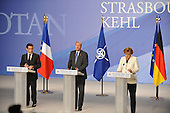 Strasbourg, France - April 4, 2009 -- Final press conference by the President of France, Nicholas Sarkozy, left, NATO Secretary General Jaap de Hoop Scheffer, center, and Angela Merkel, Chancellor of the Federal Republic of Germany, following the NATO Summit in Strasbourg and Kehl where it was announced the 28 NATO Heads of State and Government agreed uninamously to appoint Prime Minister Anders Fogh Rasmussen of Denmark as NATO's next Secretary General.  Mr Fogh Rasmussen will formally take up his duties on August 1, 2009, when the term of the current Secretary General, Jaap de Hoop Scheffer expires after five and a half years at the helm of the Alliance. .Mandatory Credit: NATO via CNP