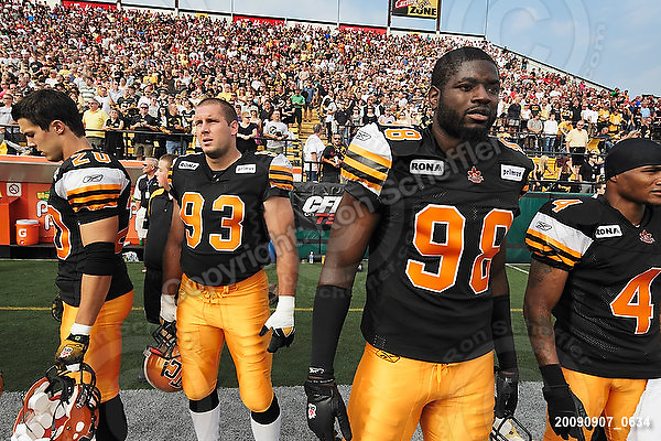 September 7, 2009; Hamilton, ON, CAN; Hamilton Tiger-Cats defensive back Dylan Barker (20) defensive tackle Matt Kirk (93) defensive end Montez Murphy (98) wide receiver Arland Bruce III (4). CFL football - the Labour Day Classic - Toronto Argonauts vs. Hamilton Tiger-Cats at Ivor Wynne Stadium. The Tiger-Cats defeated the Argos 34-15. Mandatory Credit: Ron Scheffler.