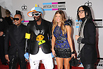 LOS ANGELES, CA. - November 21: Singers will.i.am, Taboo, Fergie and apl.de.ap of the Black Eyed Peas arrive at the 2010 American Music Awards held at Nokia Theatre L.A. Live on November 21, 2010 in Los Angeles, California.