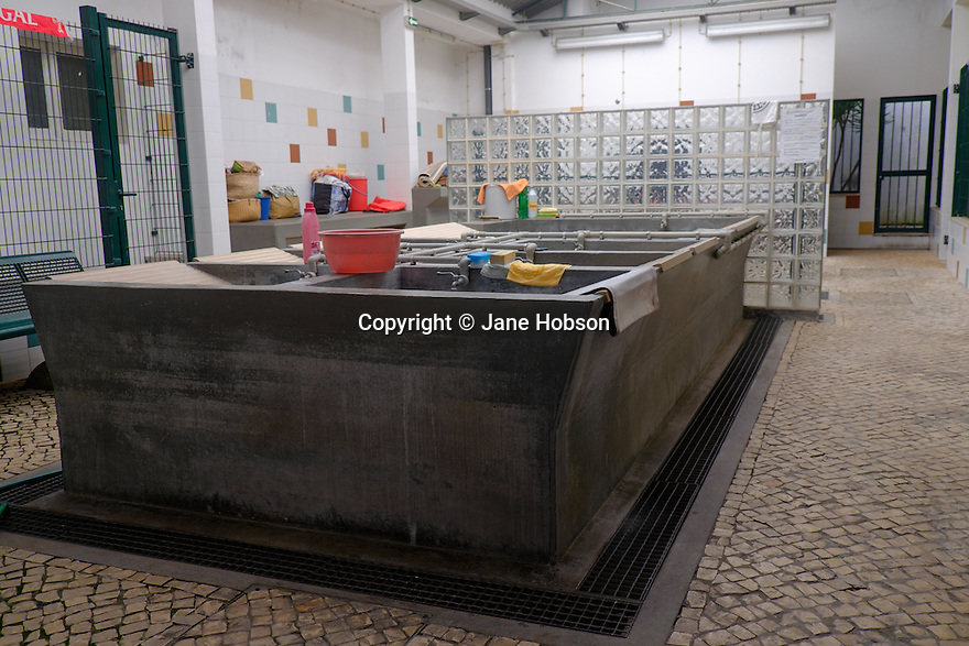 Lisbon, Portugal. 21.03.2015. Public laundry in the Alfama district of Lisbon. © Jane Hobson.