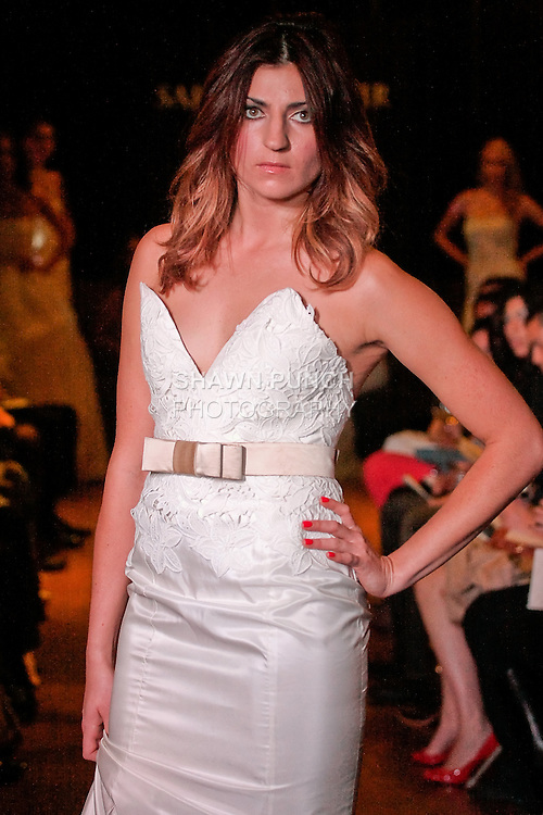 Model walks the runway in an Enamor wedding dress - cotton crothet lace silk taffeta mermaid with modified bust-line, by Sarah Jassir, for the Sarah Jassir Couture Bridal Fall 2012 Opulence collection.
