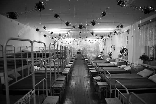 At prison colony #7 outside of Novgorod in the Novgorod region south of St. Petersburg, tidily made but spartan beds of prisoners, lined one of the dormitories adorned with new year decorations. Russia, December 15, 2008