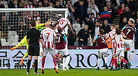 Goalkeeper Joe Hart of West Ham United saves a shot at goal from Bruno Martins Indi of Stoke City late in the game during the Premier League match between West Ham United and Stoke City at the Olympic Park, London, England on 16 April 2018. Photo by Andy Rowland.