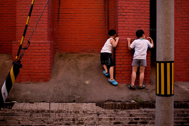 Children play outside of their hutong in Beijing, China on Friday, August 22, 2008.  Kevin German