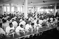 Cummins, AR - February 3rd 1968<br /> Inmates having diner. Cummins unit of Arkansas State Penitentiary. The corruption scandal of the historical penitentiary inspired the 1980 film Brubaker, which chronicled the warden's inside investigation into the corrupt southern prison system. <br /> Cummins, Arkansas. 3 f&eacute;vrier 1968.<br /> Le r&eacute;fectoire, les prisonniers dinet vers 18h.