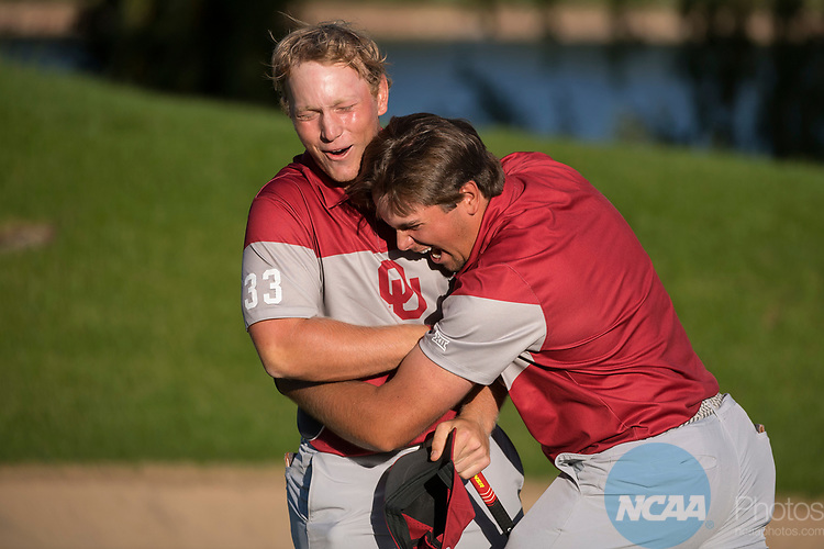 SUGAR GROVE, IL - MAY 31: Brad Dalke and Blaine Hale of the University of Oklahoma celebrate their victory during the Division I Men's Golf Team Championship held at Rich Harvest Farms on May 31, 2017 in Sugar Grove, Illinois. Oklahoma won the team national title. (Photo by Jamie Schwaberow/NCAA Photos via Getty Images)