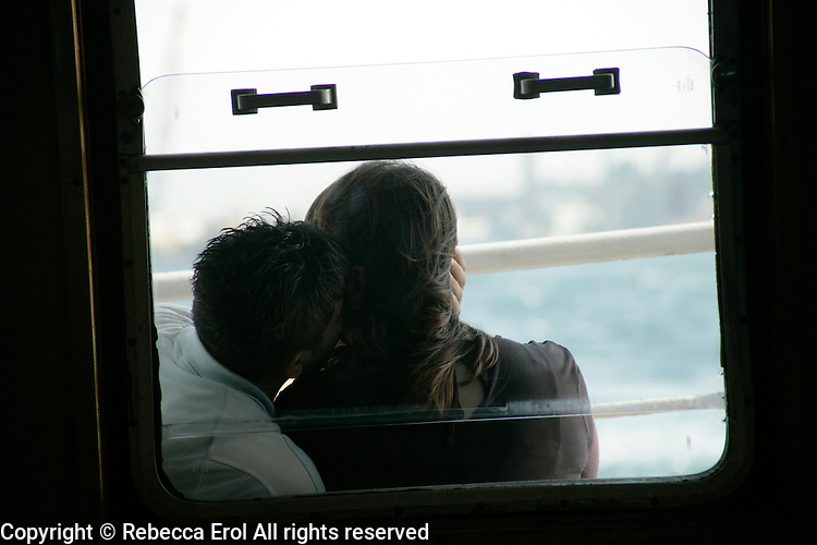 Romantic young couple on an Istanbul ferry, Turkey