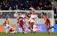 John Wolyniec (15) of the New York Red Bulls passes the ball during the second half of a Major League Soccer match between the New York Red Bulls and the Chicago Fire at Red Bull Arena in Harrison, NJ, on March 27, 2010. The Red Bulls defeated the Fire 1-0.