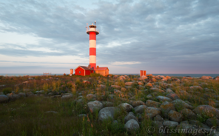Utgrynnan Island Lighthouse in the dying moments of sundown in Gulf of Bothnia between Sweden an Finland.