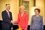 AUSTRALIA, Canberra : President Anibal Cavaco Silva of Portugal shakes hands with Australian Governor General Quentin Bryce, watched by Maria Cavaco Silva, at Government House, Canberra Australia on May 25, 2012. AFP PHOTO/Mark GRAHAM