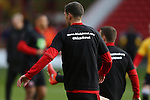 Chris Basham of Sheffield Utd warms up in KIO t-shirt during the English League One match at the Bramall Lane Stadium, Sheffield. Picture date: November 19th, 2016. Pic Simon Bellis/Sportimage