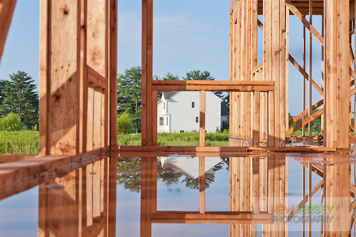 Rain soaked Wood Framed House Under Construction
