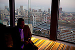 JOHANNESBURG, SOUTH AFRICA: A businessman relaxes in the penthouse venue Randlords over looking The Nelson Mandela Bridge in downtown Johannesburg, South Africa. (Photo by Per-Anders Pettersson )