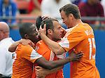Houston Dynamo midfielder Brad Davis (11) celebrates after shooting a goal during the game between the FC Dallas and the Houston Dynamo at the FC Dallas Stadium in Frisco,Texas.