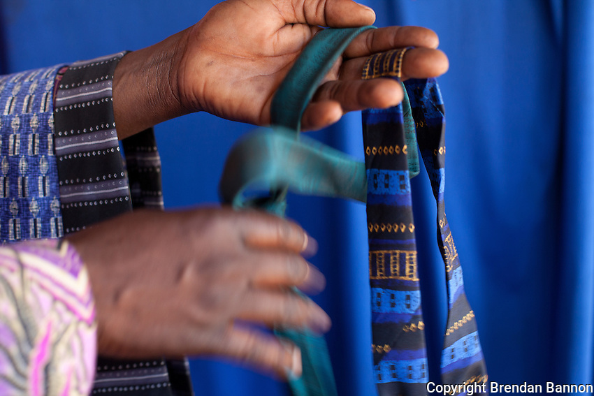 "Peter Olendo keeps a cache of neck ties for customers to  wear at his  photo studio in Kibera.            Olendo also has clip on ties for those ""with no time to waste."""