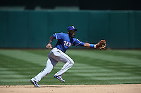 OAKLAND, CA - APRIL 23:  Elvis Andrus #1 of the Texas Rangers makes a play at shortstop against the Oakland Athletics during the game at O.co Coliseum on Wednesday, April 23, 2014 in Oakland, California. Photo by Brad Mangin