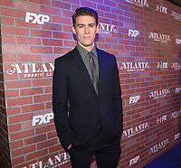 """LOS ANGELES - FEBRUARY 19: Griffin Freeman arrives at the red carpet event for FX's """"Atlanta Robbin' Season"""" at the Ace Theatre on February 19, 2018 in Los Angeles, California.(Photo by Frank Micelotta/FX/PictureGroup)"""