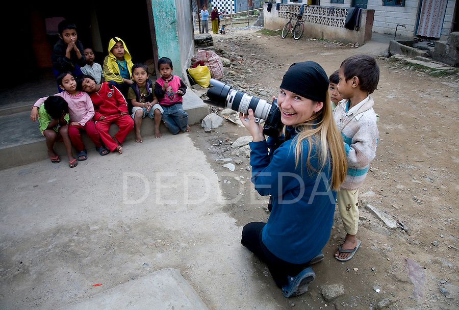 Deddeda takes photos of children at an orphanage in Pokhara, Nepal.