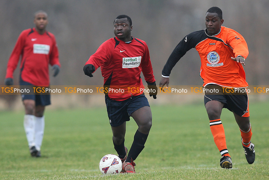 St Lucia (orange) vs Stratford Juniors - East London Sunday League Jubilee Cup Football at South Marsh, Hackney Marshes, London - 29/02/12 - MANDATORY CREDIT: Gavin Ellis/TGSPHOTO - Self billing applies where appropriate - 0845 094 6026 - contact@tgsphoto.co.uk - NO UNPAID USE.