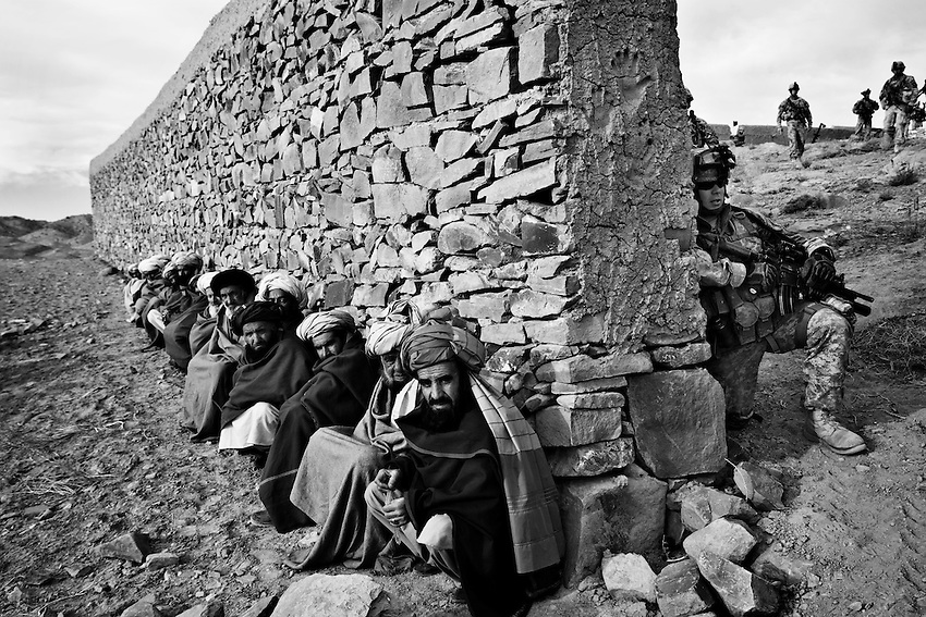Afghan elders wait to to try and negotiate the release of several detainees taken by the Afghan National Army and the US 1/506th Infantry during an operation in the village of Marzak, Paktika Province, Afghanistan, Thursday, Feb. 26, 2009.