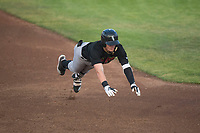 Great Falls Voyagers center fielder Romy Gonzalez (5) slides into third base during a Pioneer League game against the Idaho Falls Chukars at Melaleuca Field on August 18, 2018 in Idaho Falls, Idaho. The Idaho Falls Chukars defeated the Great Falls Voyagers by a score of 6-5. (Zachary Lucy/Four Seam Images)
