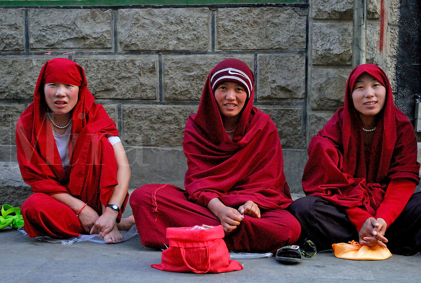 Beggars settling down for an evening of chanting and...begging, in the Barkhor, Lhasa, Tibet.