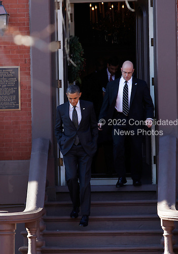 United States President Barack Obama  leaves the Blair House in Washington DC, on December 13, 2012, after attending a Christmas party organized by the National Security Agency. .Credit: Aude Guerrucci / Pool via CNP