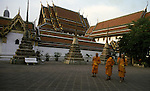 After a long day of studying, Buddhists priests depart a temple in Bangkok, Thailand. (Jim Bryant Photo).....