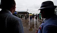 LOUISVILLE, KENTUCKY - MAY 04: Two fans wait out the rainstorm during Thurby at Churchill Downs on May 4, 2017 in Louisville, Kentucky. (Photo by Scott Serio/Eclipse Sportswire/Getty Images)