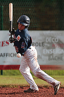 16 October 2010: Yohann Bret of Rouen is hit by a pitch during Rouen 16-4 win over Savigny, during game 1 of the French championship finals, in Savigny sur Orge, France.