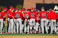 The Radford Highlanders huddle up prior to the game against the Cincinnati Bearcats at Wake Forest Baseball Park on February 22, 2014 in Winston-Salem, North Carolina.  The Highlanders defeated the Bearcats 6-5.  (Brian Westerholt/Four Seam Images)
