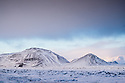 Iceland. 02.02.2017. The view from outside Hellisheidi (Hellisheidarvirkjun)Geothermal Power Station, South Iceland. The power station is located in the Hengill volcano area. Hengill is a volcano made from palagonite tuff and its highest point is around 800 meters above sea level. Hengill geothermal area is located in the middle of the western volcanic zone, on the plate boundary between North America and European plates. The area is one of the most powerful geothermal areas in the world with several thousand of hot springs at the surface and a giant magma chamber lying underground. Hengill volcano is still active, although its last eruption occurred about 2 000 years ago. Photograph © Jane Hobson.