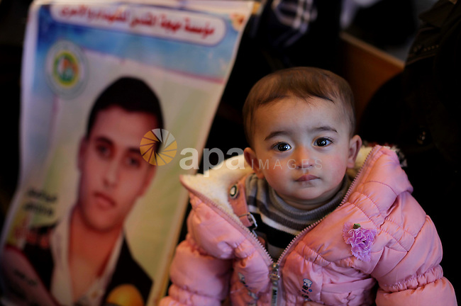 A Palestinian child take parts in a protest calling for the release of Palestinian prisoners from Israeli jails in front of the Red cross office in Gaza city, Jan. 14, 2013. Photo by Ashraf Amra