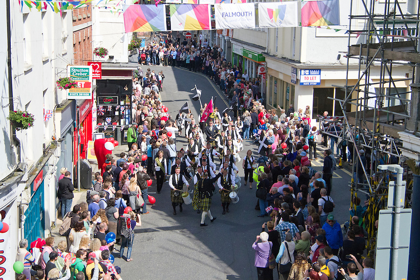 Hundreds of people gathered on Falmouth High Street to welcome the Olympic Torch in the early stages of it's relay journey across the United Kingdom in the run up to the 2012 Games.