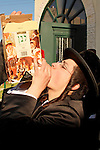 Israel, Bnei Brak. The Premishlan congregation on Purim holiday. A Hassid is drinking wine, 2005<br />