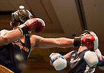 February 3, 2012:  Cal boxer Jose Jiminez, left,  lands a punch to the chin of Nevada boxer Anthony Donohue in the 165 pound weight class at the Eldorado Convention Center on Friday night in Reno, Nevada.  Jiminez won the fight when the referee stopped the contest in the third round.