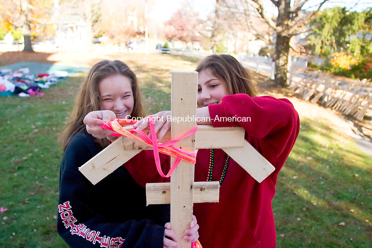 COLEBROOK, CT- 14 OCT 06- 101406JT01- <br /> Nicole Bartlett and Alyssa Bascetta, both 16, dress their scarecrow with a bathing suit Saturday morning at the Colebrook Town Green during an event sponsored by the Colebrook Junior Firefighters.<br /> Josalee Thrift Republican-American