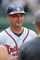 Coach Nestor Perez (4) of the Rome Braves delivers the lineup card before a game against the Greenville Drive on Sunday, June 14, 2015, at Fluor Field at the West End in Greenville, South Carolina. Rome won, 5-2. (Tom Priddy/Four Seam Images)