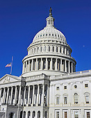 East Front of the United States Capitol on Thursday morning, July 1, 2010 looking south.  The flag is at half staff in honor of the late United States Senator Robert Byrd (Democrat of West Virginia).  The Moon is in the sky next to the dome on the right..Credit: Ron Sachs / CNP