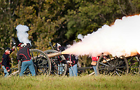 NWA Democrat-Gazette/BEN GOFF @NWABENGOFF<br /> Union artillery fires on the confederates on Friday Sept. 25, 2015 during the Battle of Pea Ridge Civil War reenactment at Webb Farm near Pea Ridge. The event continues with battle reenactments at 2:00p.m. on Saturday and at 11:00a.m. Sunday.