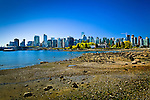 Rocky stretch of beach, Stanley Park, Vancouver, B.C, Canada on a sunny day, early summer. Downtown skyline is in the background.