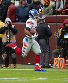 New York Giants running back Saquon Barkley (26) celebrates as he scores after a 78 yard run in the second quarter against the Washington Redskins at FedEx Field in Landover, Maryland on Sunday, December 9, 2018.<br /> Credit: Ron Sachs / CNP<br /> (RESTRICTION: NO New York or New Jersey Newspapers or newspapers within a 75 mile radius of New York City)