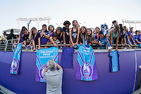 Orlando, Florida - Sunday, May 8, 2016: Orlando Pride head coach Tom Sermanni signs an autograph for a fan following his team's 2-0 victory during a National Women's Soccer League match between Orlando Pride and Seattle Reign FC at Camping World Stadium.