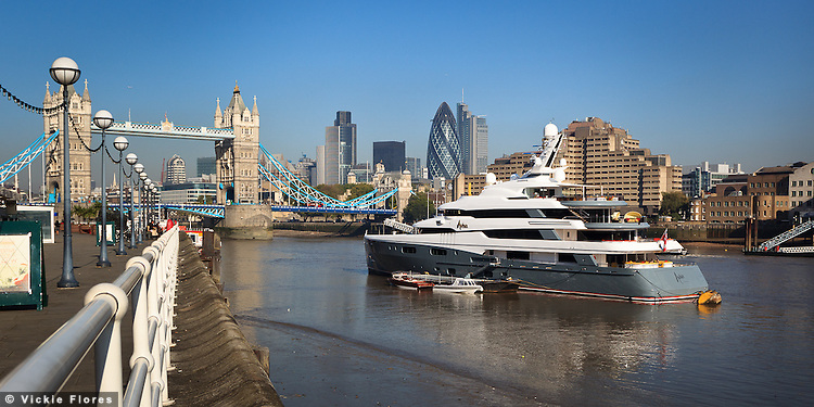 Aviva 3 superyacht owned by billionaire Joe Lewis moored outside Butlers Wharf near Tower Bridge for 6 weeks over the summer of 2011. A special mooring was built on the River Thames at Shad Thames for the 223-foot yacht that arrived at the end of August and left on 7/8 October 2011...Aviva has 6 decks that guests can move around in a circular glass elevator. For more Aviva facts and news see Wikipedia http://en.wikipedia.org/wiki/Aviva_(yacht)