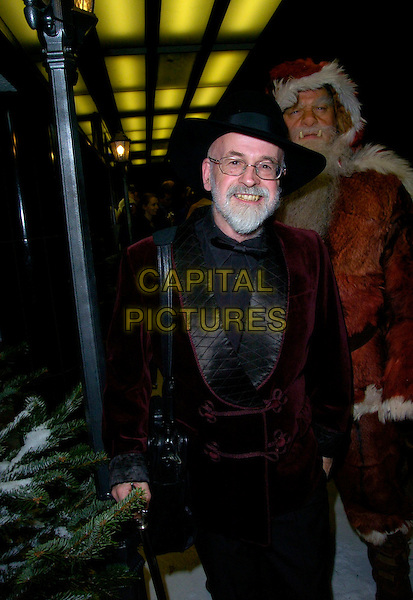 "TERRY PRATCHETT.The ""Hogfather"" world TV premiere, Curzon Mayfair cinema, London, UK..November 27th, 2006.half length cane black hat santa clause dress up costume burgundy.CAP/CAN.©Can Nguyen/Capital Pictures"