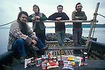 Tim Severin ( centre ) and examples of the food they were taking with them.  Brendans Voyage Sea trials southern Ireland.
