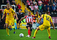 Lincoln City's Nathan Arnold gets between Morecambe's Steven Old and Sam Lavelle<br /> <br /> Photographer Andrew Vaughan/CameraSport<br /> <br /> The EFL Sky Bet League Two - Lincoln City v Morecambe - Saturday August 12th 2017 - Sincil Bank - Lincoln<br /> <br /> World Copyright &copy; 2017 CameraSport. All rights reserved. 43 Linden Ave. Countesthorpe. Leicester. England. LE8 5PG - Tel: +44 (0) 116 277 4147 - admin@camerasport.com - www.camerasport.com