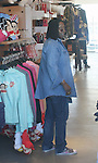 4-18-09.Exclusive .whoopi Goldberg shopping at The Paul Frank store with her family in Los Angeles ca .wearing Ed Hardy shoes ...AbilityFilms@yahoo.com.805-427-3519.www.AbilityFilms.com.