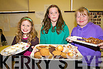 Katie and Niamh Faulds and Karen Leader displaying some of the home-baked goods produced and sold by students at Raheen National School last Thursday to raise funds for Haiti.